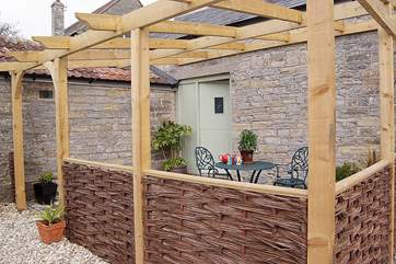 There is a lovely pergola outside the property, creating a place to sit outside.