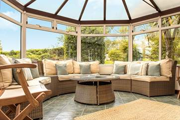 The large circular conservatory is ideal to sit in and enjoy the garden