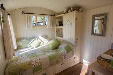 The very comfortable bed looks straight out over the lake and countryside beyond.