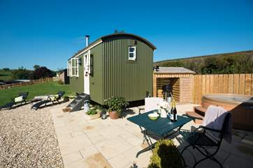 The spacious patio area with its hot tub, barbecue  and table and chairs is private and sheltered and looks over the lovely countryside views.