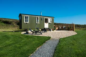Gorgeous Shepherd's Joy with its private patio and hot tub situated in a beautiful meadow overlooking a lake and the countryside beyond.