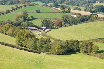 The Owners have created farm walks for your pleasure - worth the climb for the most outstanding views across Devon. You can just see the huts in the middle of the photo.