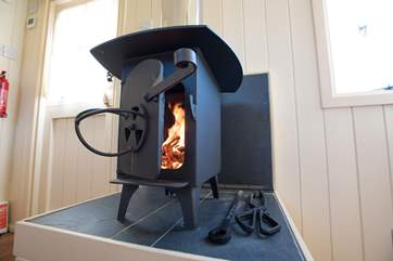 The cosy little wood-burner lets out plenty of heat for the cooler months but don't forget you have underloor heating too!