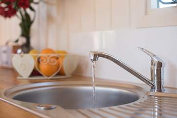 Running hot and cold water to your kitchen sink.