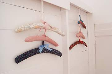 The Owners have made some pretty covered hangers which are a great storage solution.