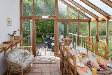 French doors lead from the dining-room to the outside terrace.
