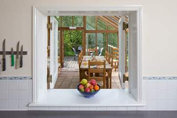 No Need To Feel Isolated In The Kitchen A Serving Hatch Links Dining