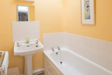 The separate family bathroom is light and cheery, perfect for a soak at the end of the day.