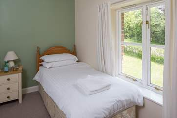 This is Bluebell, a spacious single bedroom that looks out over the front of the cottage. It has an en suite shower-room.