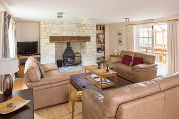 The spacious living-room has a cosy wood-burner and plenty of room for all the family.