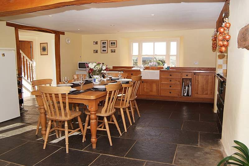You come into this fantastic farmhouse kitchen with flagstone floor and a classic farmhouse table - the heart of the house.