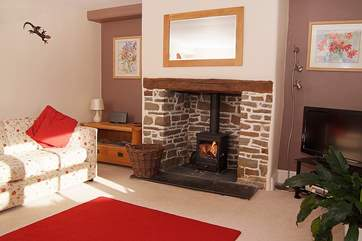 The living-room has a wood-burner and is a friendly family room to relax in.