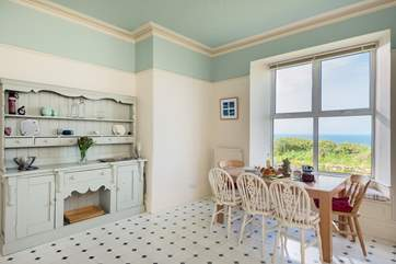 The light and spacious kitchen has a super view from the large picture window.