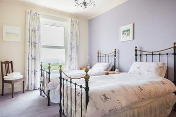 The twin bedroom, Bedroom two, is spacious and has sea views.