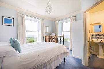 This double-aspect, Bedroom 3, has sea views from both windows and an en suite.