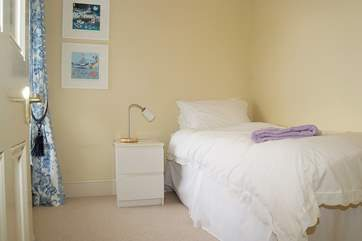 The pretty single bedroom is linked to the main bedroom with a door in between, and shares the shower-room.