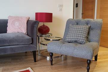 Shades of grey and red can be found in the quality fabrics, paintings and furnishings throughout the apartment.