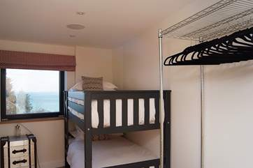 The second bedroom has bunk-beds.
