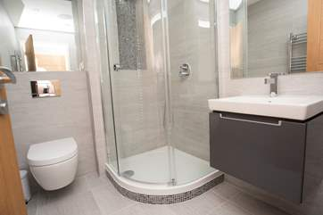 The en suite shower-room with large corner shower cubicle and wall hung Villeroy and Boch hand-basin and WC.
