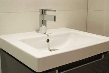 The en suite shower-room is equipped with wall hung wash-basin and WC courtesy of Villeroy and Boch.