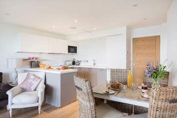 The gorgeous open plan living area, beautifully furnished in pastel colours.