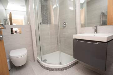 The en suite shower-room includes a large corner shower cubicle.