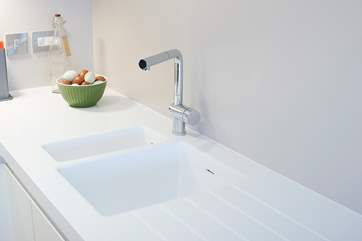 The crisp white sink and worktop.