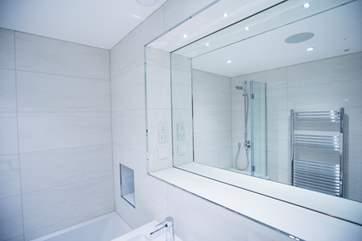 The bathroom mirrors are equipped with de-mist technology.