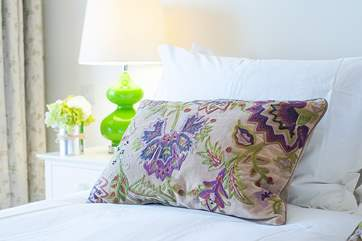 The purple and green theme continues in the bedroom.