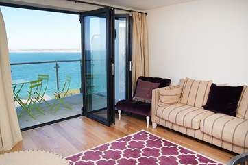 The living area looks out over the sea.