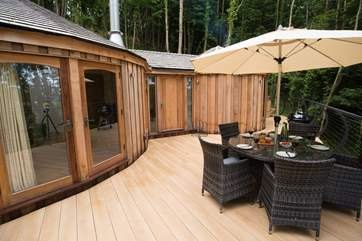 The deck sits out over the woodland.