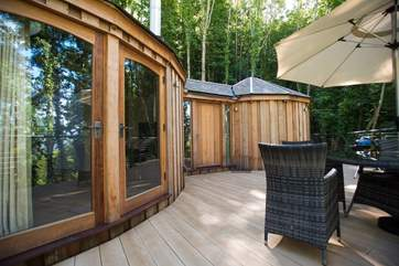 There are double doors from the living-area onto the deck as well as the large entrance door into the hallway.