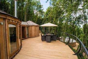 Another view of the deck with Owl Cedar Yurt below (but spaced well apart).
