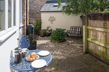 There are two private enclosed courtyard gardens to sit out in, this one is at the rear or the cottage.