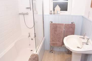 The bathroom is really pretty - a three-quarter sized bath fits perfectly and you have the flexibility of a shower too (there is also a downstairs WC).