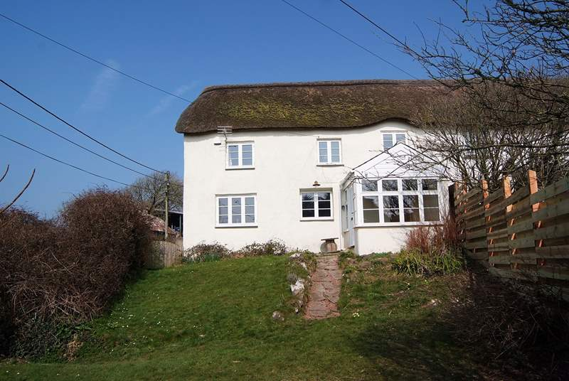 Kentisbury Cottage has an enclosed garden with a wooden fence on one side and a bank and hedging to the other. The garden seating and barbecue are at the bottom end of the garden.