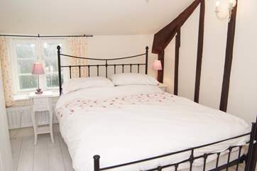 This bedroom also has a double bed and overlooks the garden.