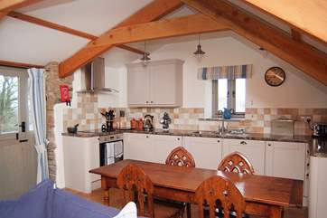 The very well-equipped kitchen and the door out to the patio, accessed by a flight of wooden steps.