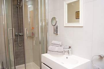 The fresh white shower-room for Bedroom 1.