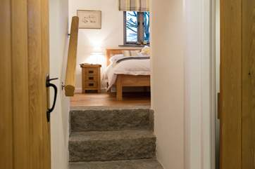 The granite steps that lead up to Bedroom One add to the overall character of the Barn
