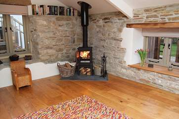 The cosy wood-burner gives extra heat in the living-room.
