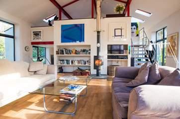 The sitting-room is below the galleried bedroom.