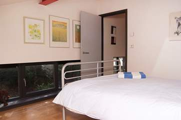 The single bedroom has a large comfortable bed.
