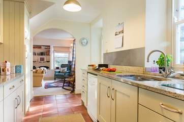 The kitchen is light and airy and enjoys views over the back garden.