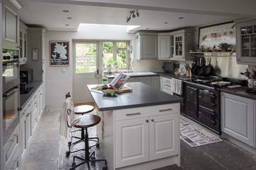The farmhouse-style kitchen has all the equipment that you could need; an electric aga, induction hob and electric double oven.