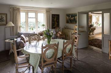 A second dining table with the entrance hall beyond.
