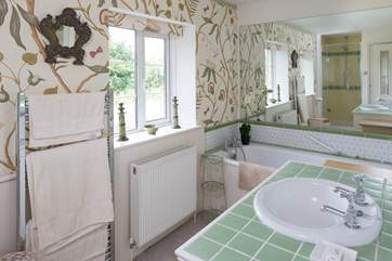 The master bedroom en suite has a lovely deep bath and separate shower cubicle.
