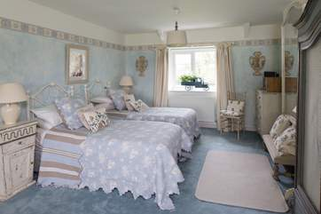 Bedroom 2 has a zip and link bed which can be made up as a 6ft bed or 3ft twin beds, a spacious en suite bathroom and views over open countryside.