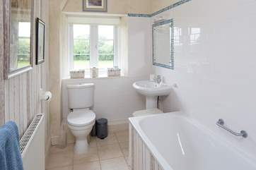 The en suite bathroom for bedroom 2 has a bath and shower cubicle.
