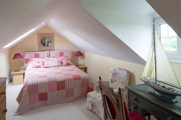 The second floor bedroom suite (bedroom 4) is tucked away at the top of the house, with a double bed.